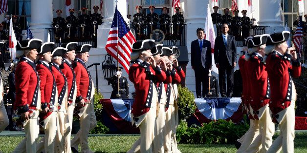 President Barack Obama and Japanese Prime Minister Shinzo Abe watch as the United States Army Old Guard...
