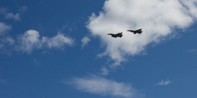 Two F-16s flying past at an airshow in Kristiansand, Norway. Beautifully contrasted in front of white