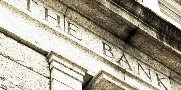 A detail view of the words THE BANK chiseled in