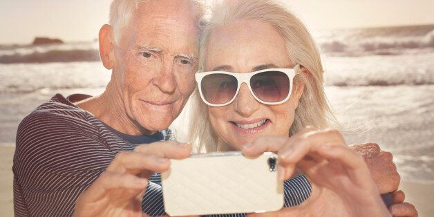 Senior couple taking self-portrait with