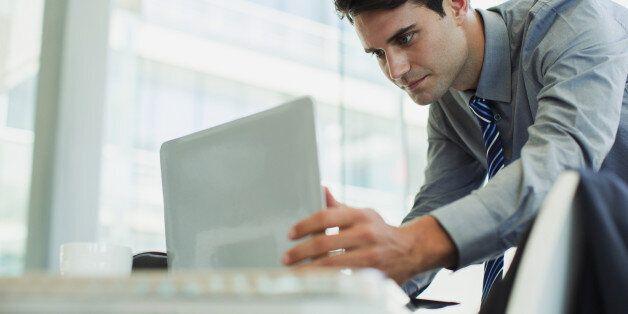 Businessman using laptop in