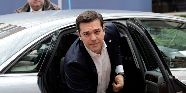 Greek Prime Minister Alexis Tsipras arrives for an European Union Summit at the EU headquaters in Brussels,...