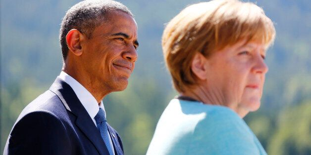 U.S. President Barack Obama and German Chancellor Angela Merkel make speeches after signing the guest...