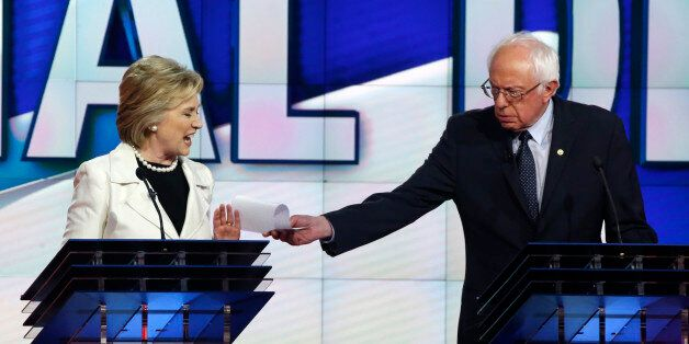 Democratic U.S. presidential candidate Hillary Clinton reacts as rival candidate Senator Bernie Sanders...