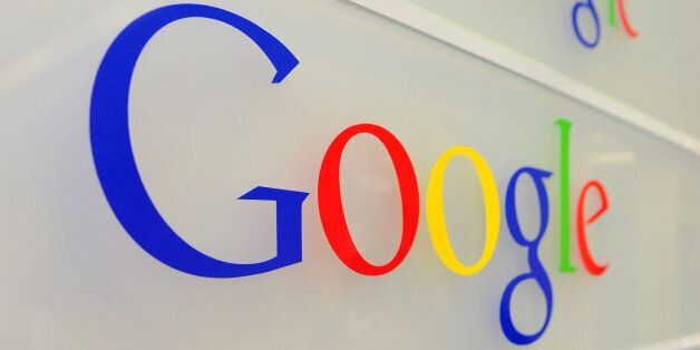 Google logo is seen on a wall at the entrance of the Google offices in Brussels on February 5, 2014....