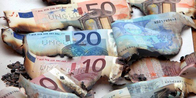 Burnt euro notes, burnt because they were unusable for various reasons, are displayed in the money museum...