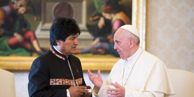 Bolivia's President Evo Morales, left, and Pope Francis share a word on the occasion of their private...