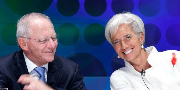 International Monetary Fund (IMF) Managing Director Christine Lagarde (R) laughs with Germany's Finance...