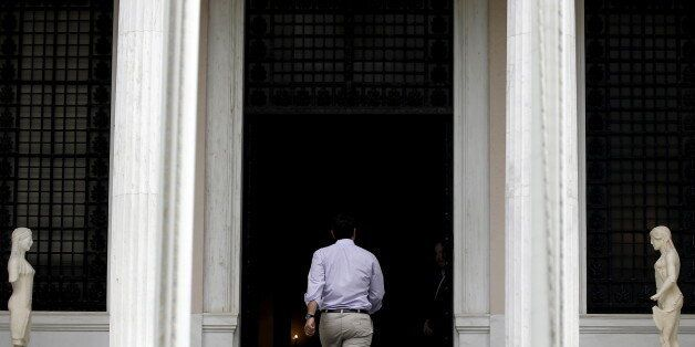 Greek Prime Minister Alexis Tsipras arrives at his office in Athens, Greece July 11, 2015. Tsipras won...