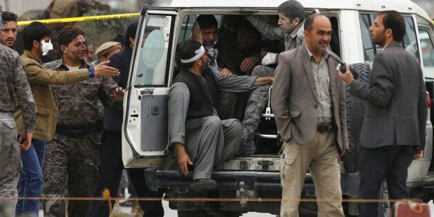 ATTENTION EDITORS - VISUAL COVERAGE OF SCENES OF INJURY OR DEATH Afghan security forces transport injured...