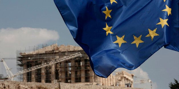 A European Union (EU) flag flutters in front of the temple of the Parthenon in Athens, Greece, Saturday,...