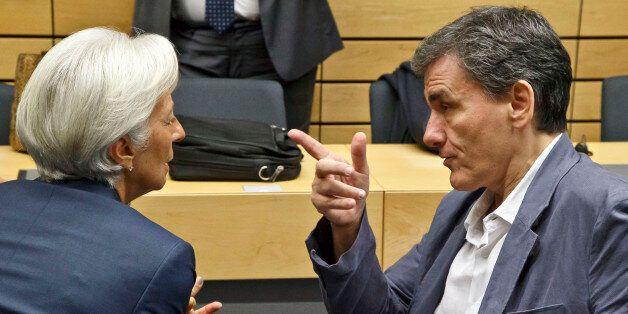 Greek Finance Minister Euclid Tsakalotos, right, speaks with Managing Director of the International Monetary...