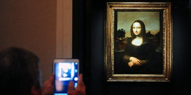 Members of the media take pictures during the media preview of The World Premiere of Leonardo Da Vinci's...