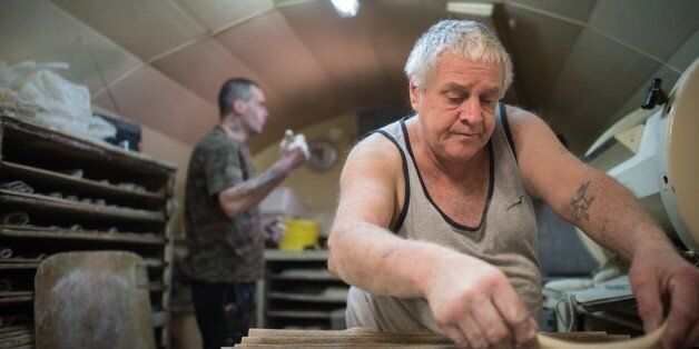 Michel Flamant (R) and Jerome (L) work in their bakery on March 23, 2016, in Dole, eastern France.Michel...