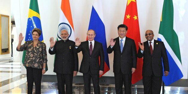 (L-R) Brazil's President Dilma Rousseff, Indian Prime Minister Narendra Modi, Russian President Vladimir...