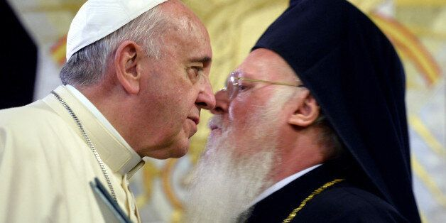 Pope Francis, left, and Ecumenical Patriarch Bartholomew I greet each other after issuing a joint declaration,...
