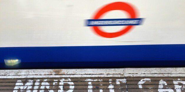 Acton tube station platform with sign MIND THE GAP 8 July 2015.