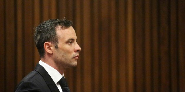 Oscar Pistorius sits in the dock in a courtroom at the High Court in Pretoria, South Africa, Tuesday...