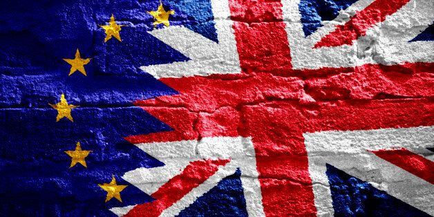 Brexit. Flags of the United Kingdom and the European Union on a brick