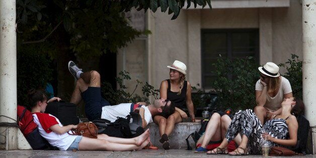 Tourists relax under trees in central Athens, Greece August 4, 2015. Southeastern Europe and the Middle...