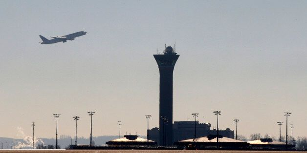 An airplane takes-off past a control tower at the Charles-de-Gaulle airport in Roissy on the eve of an...