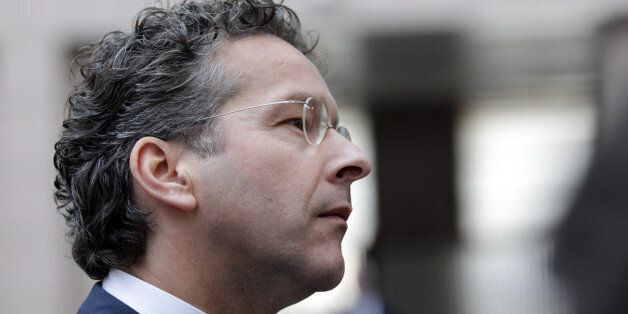 Dutch Finance Minister and chair of the eurogroup finance ministers Jeroen Dijsselbloem talks with journalists...