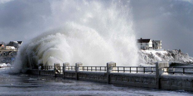 FILE In this photo taken Friday Jan. 3, 2014 heavy surf breaks over the seawall during a winter storm,...