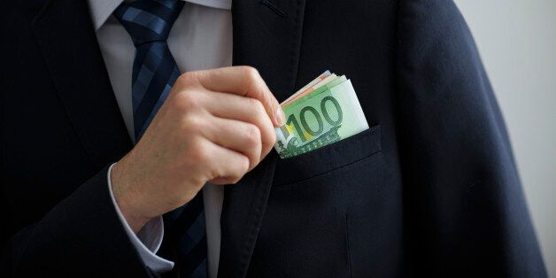 Berlin, Germany - March 23: In this Photo Illustration a person puts euro bills in the pocket of his...