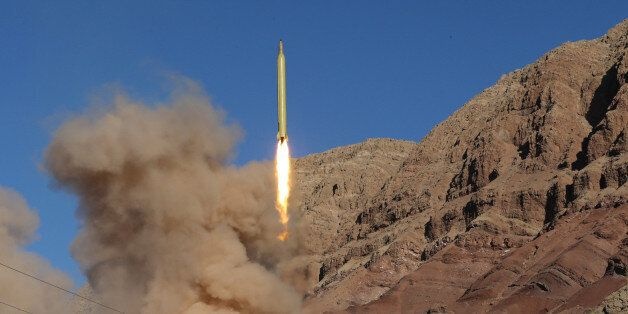 TOPSHOT - A long-range Qadr ballistic missile is launched in the Alborz mountain range in northern Iran...