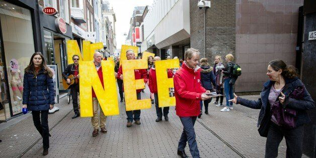 Dutch member of the Socialist Party (SP) Harry van Bommel hands out flyers against a referendum on the...