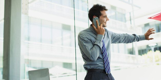 Businessman talking on cell phone at