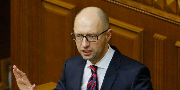 Ukrainian Prime Minister Arseniy Yatsenyuk speaks during an annual report in Parliament in Kiev, Ukraine,...