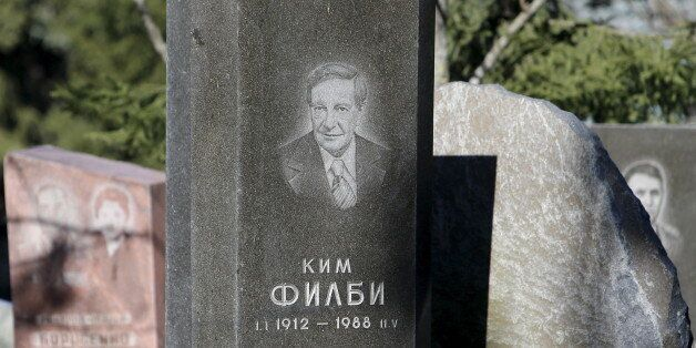 A view shows the gravestone (C) of British double agent Kim Philby at a cemetery in Moscow, Russia, April...