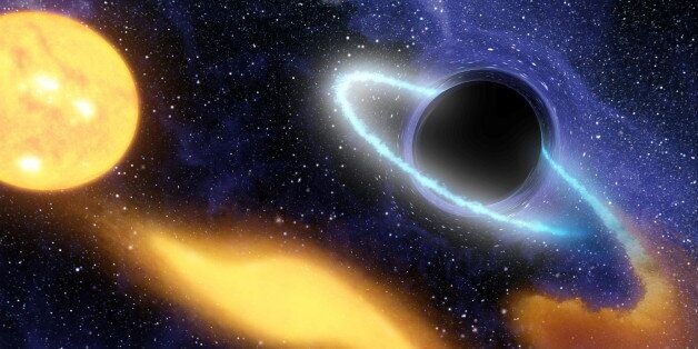 Supermassive black hole at the center of a remote galaxy digesting the remnants of a star. (Photo by...