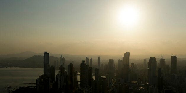 Panama City skyline is silhouette at sunset in Panama, Monday, April 4, 2016. Panama's president says...