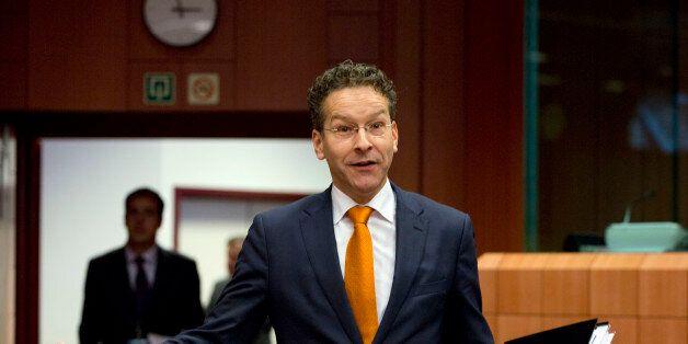 Dutch Finance Minister Jeroen Dijsselbloem gestures as he arrives for a meeting of eurogroup finance...