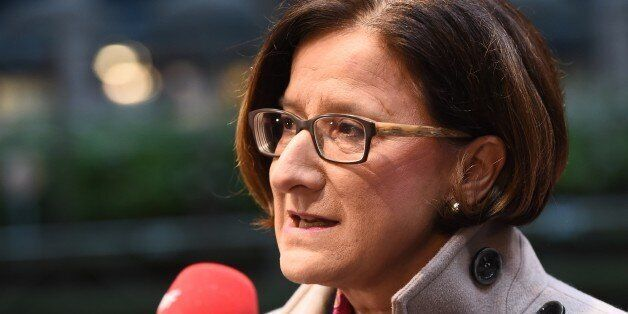Austria's Interior Minister Johanna Mikl-Leitner speaks to journalists as she arrives for a Justice and...