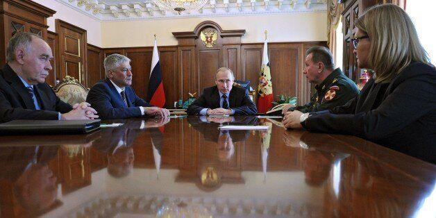 Russian President Vladimir Putin (C) meets with Interior Minister Vladimir Kolokoltsev (2ndL), Russia's...