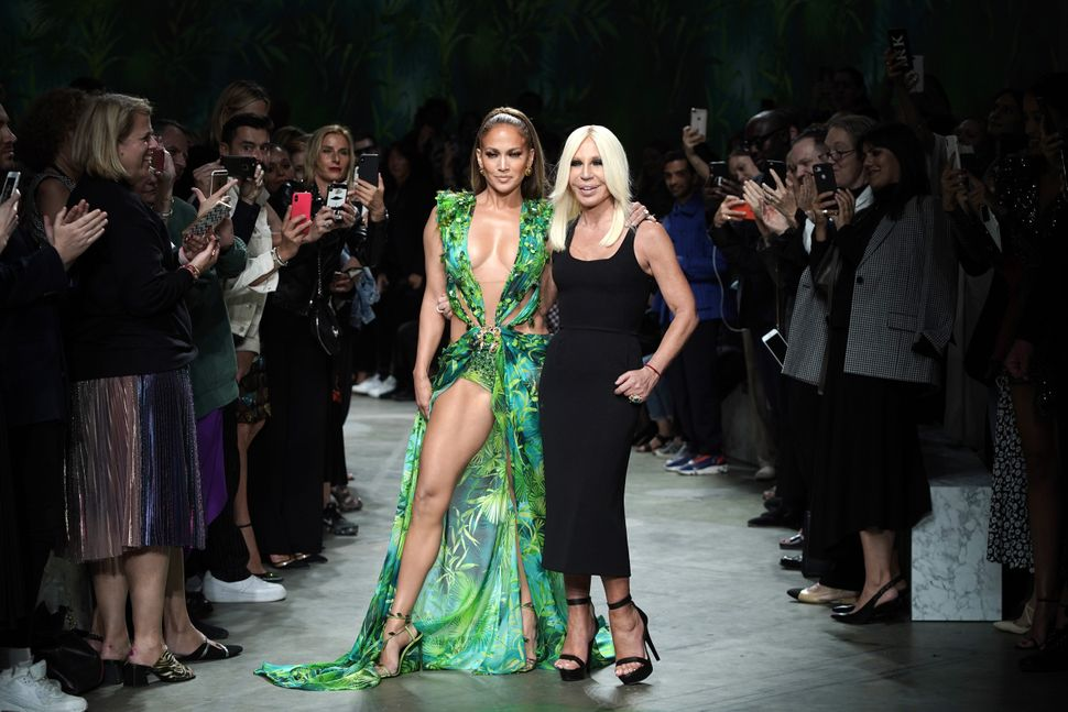 MILAN, ITALY - SEPTEMBER 20: Jennifer Lopez and Donatella Versace walk the runway at the Versace show during the Milan Fashion Week Spring/Summer 2020 on September 20, 2019 in Milan, Italy. (Photo by Vittorio Zunino Celotto/Getty Images)