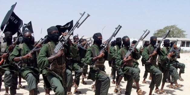 Hundreds of newly trained Shabaab fighters perform military exercises in the Lafofe area some 18Km south...