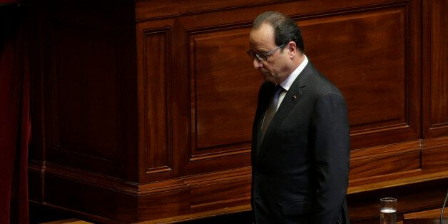 French President Francois Hollande leaves after delivering a speech at the Versailles castle, west of...