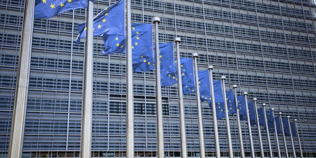 'European commission in Brussels, Belgium; EU flags in front of the buildingsee other similar
