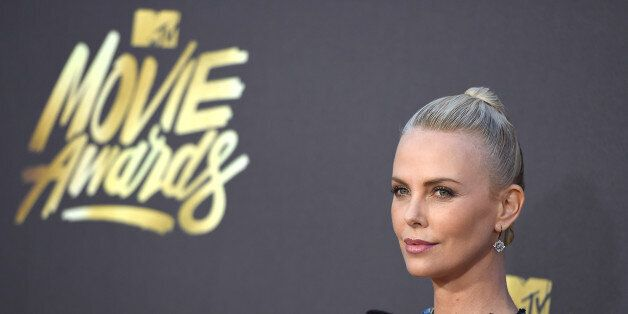 Charlize Theron arrives at the MTV Movie Awards at Warner Bros. Studios on Saturday, April 9, 2016, in...
