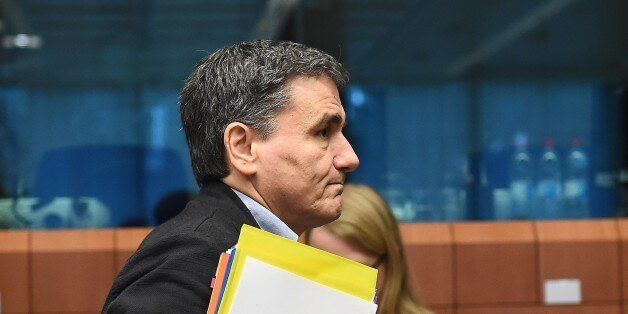 Greece's Finance Minister Euclid Tsakalotos arrives for an Eurogroup Finance Ministers' meeting at the...