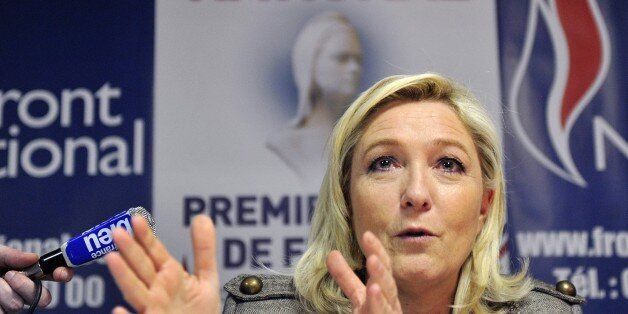 Leader of the french far-right Front National (FN) party Marine Le Pen speaks during a press conferences...