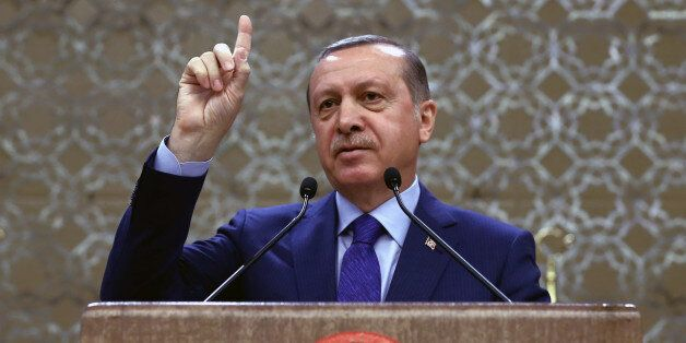 Turkish President Recep Tayyip Erdogan addresses a meeting of local administrators in Ankara, Turkey,...