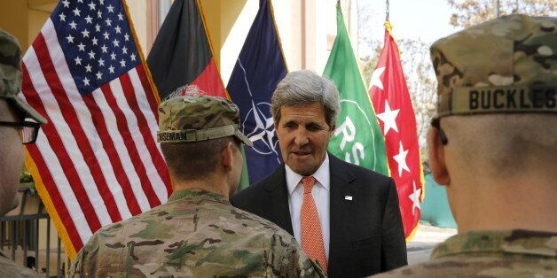U.S. Secretary of State John Kerry meets U.S. military personnel at Resolute Support Headquarters in...