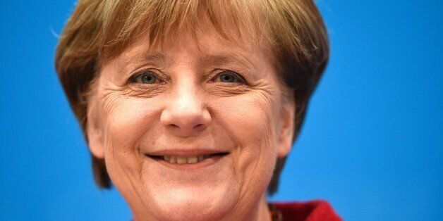 German Chancellor and head of the Christian Democratic Union (CDU) Angela Merkel smiles at a press conference...