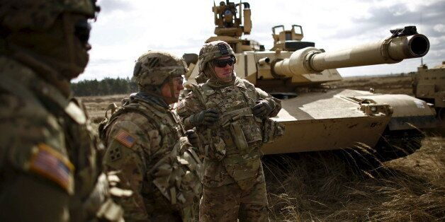 Members of the U.S. 2nd Battalion, 7th Infantry Regiment, 1st Brigade Combat Team, 3rd Infantry Division...