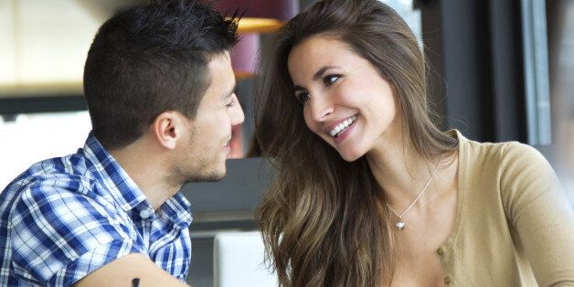 Portrait of young couple in love at a coffee shop